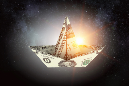 Ship made of dollar banknote floating in air. Mixed media Stock Photo