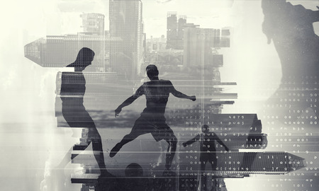 Double exposure of soccer game players and modern cityscape