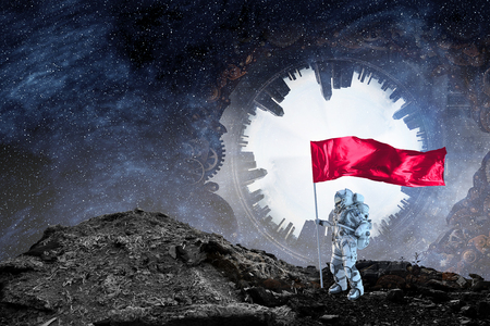 Astronaut man with flag in hand. 스톡 콘텐츠 - 103350764