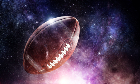 Rugby ball against abstract space purple background