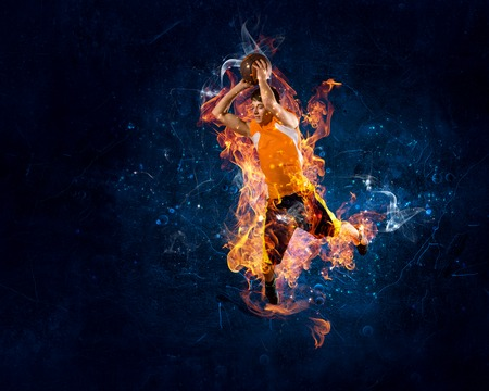 Basketball player in fire flames throwingn ball