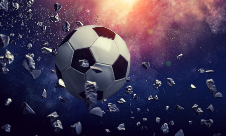 Soccer ball flying on the abstract space background 版權商用圖片