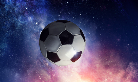 Soccer ball flying on the abstract space background Stock fotó