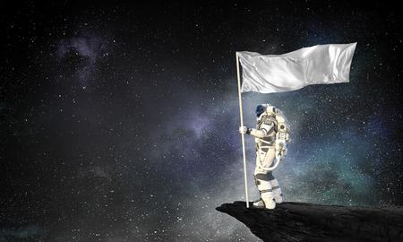 Astronaut man with flag in hand. Mixed media Standard-Bild