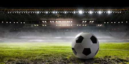 Soccer ball on field of stadium with light. Mixed media Stock Photo - 104681228