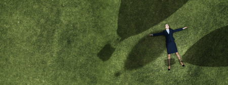 Businesswoman on grass dreaming 스톡 콘텐츠