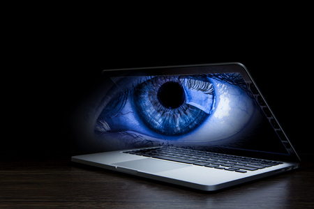 Female eye from laptop