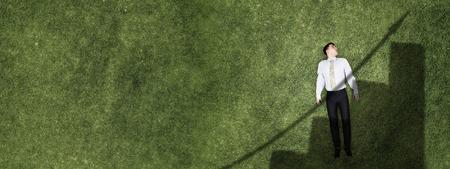 Businessman on green grass