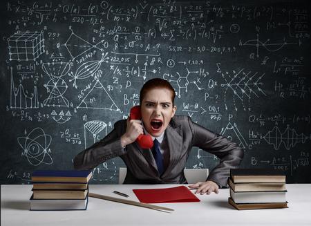 Aggressive red hair teacher . Mixed media Imagens