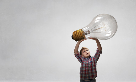 Boy catch light bulb. Mixed media