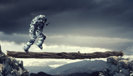 Spaceman running fast. Mixed media Stock Photo