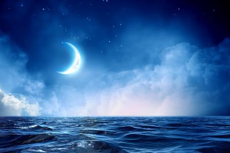 Half moon in starry sky Stock Photo