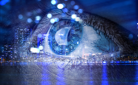 Close up of human eye against modern city background. 3d rendering Banco de Imagens