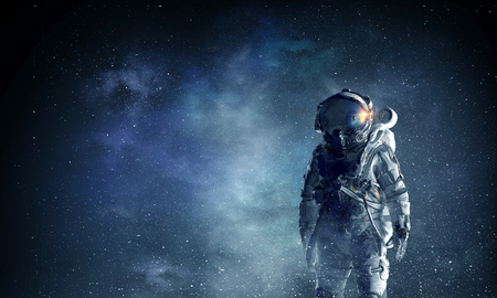 Spaceman in suit against dark starry sky. Mixed media