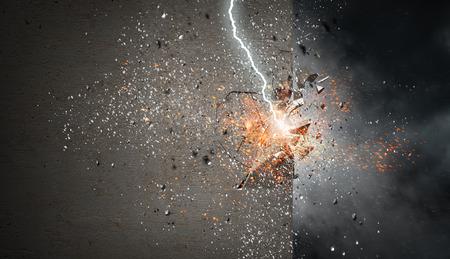 Lightning bolt striking concrete wall. Mixed media 版權商用圖片