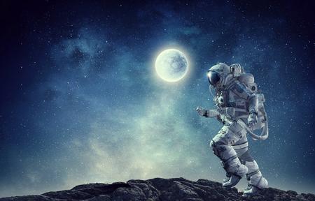 Spaceman run on rope. Mixed media Stock Photo