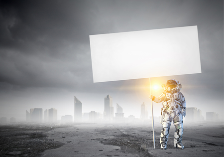 Spaceman with banner. Mixed media Stockfoto