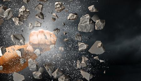 Hand breaking through the wall. Mixed media 免版税图像