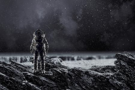 Spaceman landing planet. Mixed media 스톡 콘텐츠