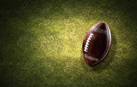 Rugby ball on grass Stockfoto