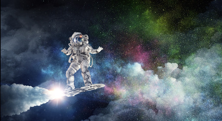 Spaceman on flying board. Mixed media Banque d'images