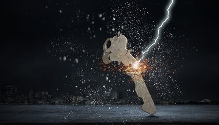 Lightning striking key. Mixed media Reklamní fotografie