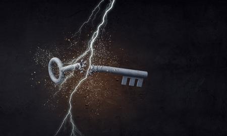 Lightning striking key. Mixed media Stock Photo