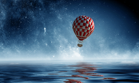 Air balloon over water. Mixed media