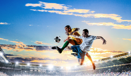 Soccer players at stadium. Mixed media Stock Photo