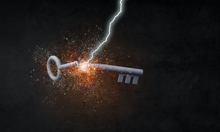 Lightning striking key. Mixed media Banco de Imagens