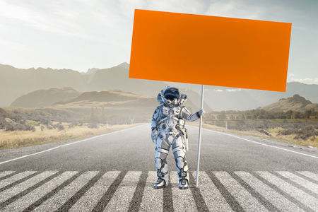 Spaceman with banner. Mixed media Фото со стока