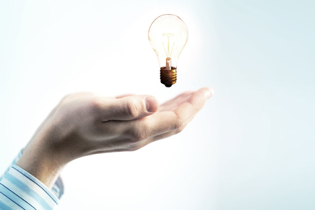 Glass bulb in hands