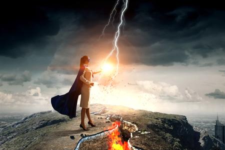 Super woman in sky. Mixed media
