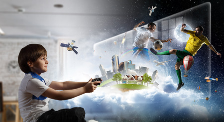 Boy playing a video game. Mixed media Stock Photo