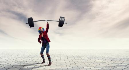 Funny clown fitness . Mixed media Reklamní fotografie