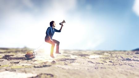 Man announcing something in megaphone