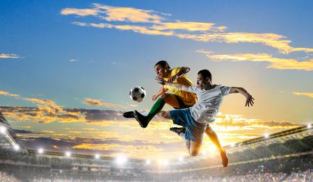 Soccer players at stadium. Mixed media Stok Fotoğraf