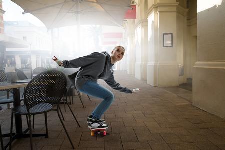 Teenager girl ride her skateboard. Mixed media