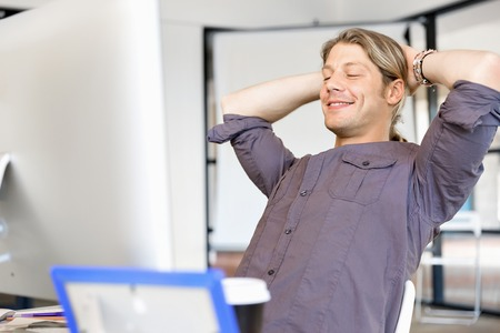 The young businessman is relaxing at work in office