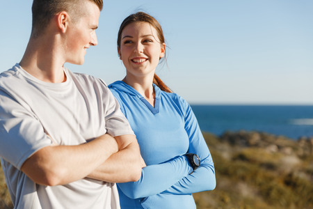 Young couple on beach training and exercising together Stockfoto