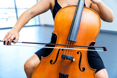 Young woman playing a cello Stock Photo