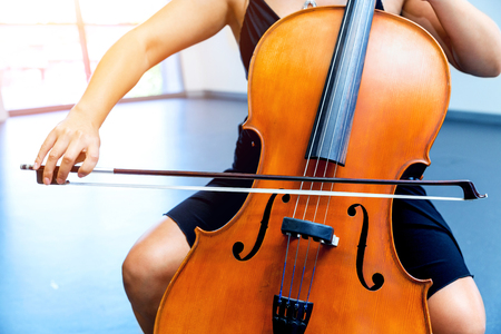 Young woman playing a cello Фото со стока