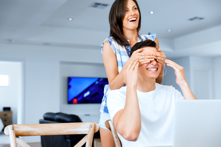 Young woman covering eyes of her boyfriend Stock Photo