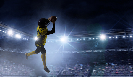 American football player in yellow sport wear. Mixed media