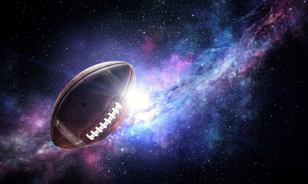 American football ball floating in open space