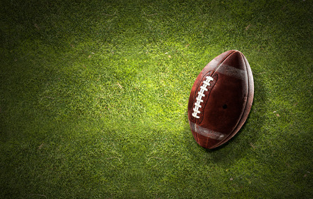 Close up of rugby ball on green field