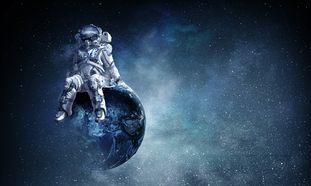 Spaceman is sitting on Earth planet.