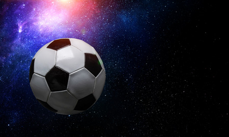 Soccer ball floating in open space against starry background