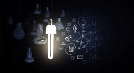 Bright idea in darkness Фото со стока
