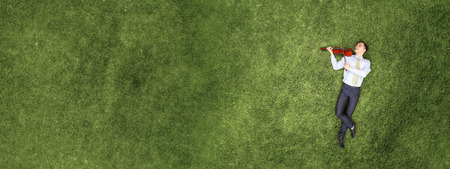 Businessman on green grass